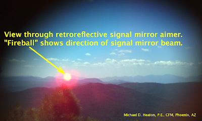 View through retroreflective signal mirror aimer